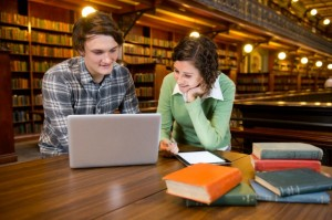 young couple studing in a library